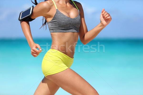 Corrida mulher da aptidão corredor telefone rápido Foto stock © Maridav