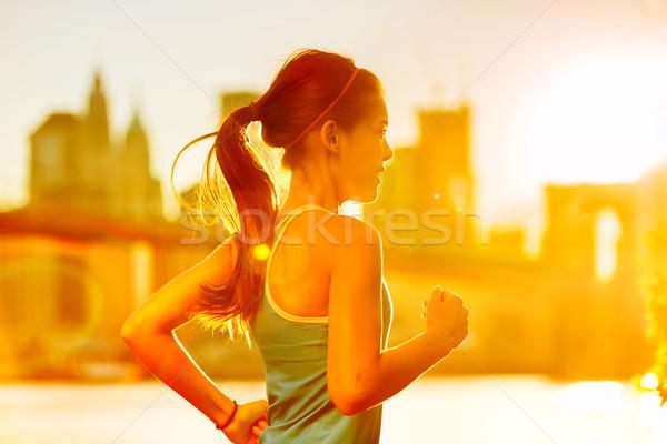 Running woman Asian runner in New York city sunset Stock photo © Maridav