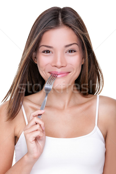 Asian woman eating hungry to eat food with fork Stock photo © Maridav