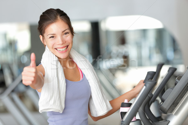 Happy fitness woman thumbs up in gym Stock photo © Maridav