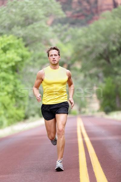 Runner man running Stock photo © Maridav