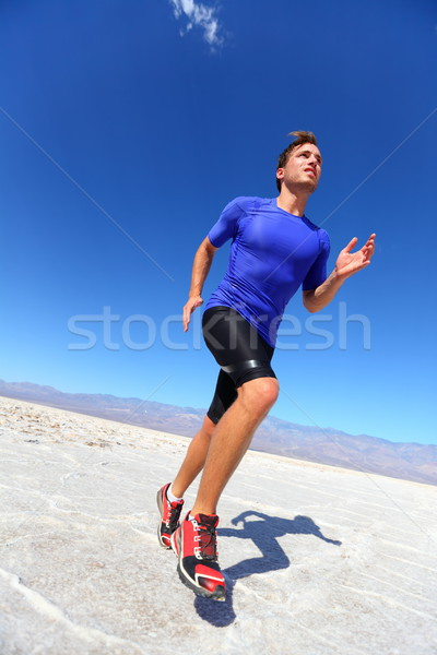 Running sport athlete man sprinting in trail run Stock photo © Maridav