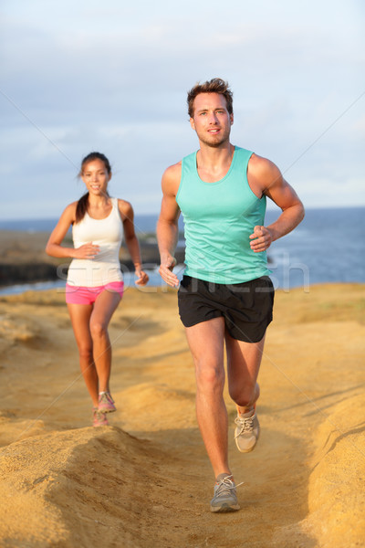 Runners couple jogging for fitness running outside Stock photo © Maridav