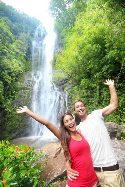 Hawaii tourist people happy by waterfall Stock photo © Maridav