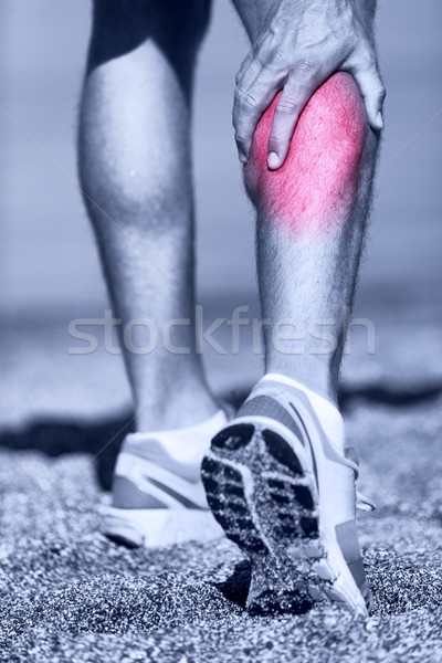 Muscle injury - Man running clutching calf muscle Stock photo © Maridav