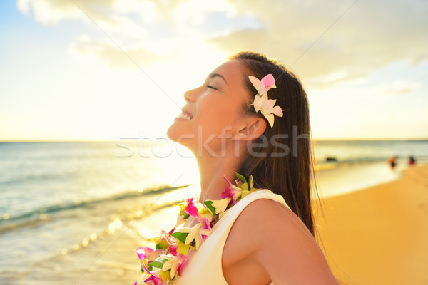 Happy woman relaxing on Hawaii beach vacation Stock photo © Maridav