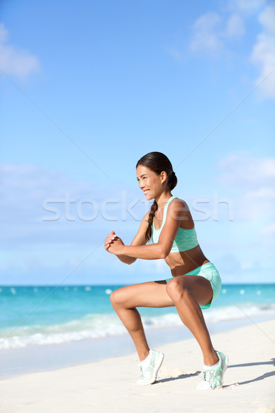 Fitness woman doing bodyweight workout training calves with plie squat exercise Stock photo © Maridav