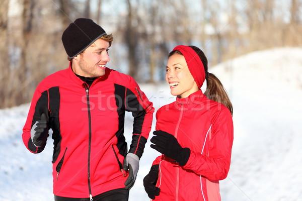 Couple running in winter Stock photo © Maridav
