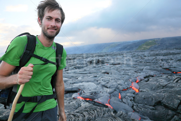 Hawaii hiker hiking by flowing lava Stock photo © Maridav