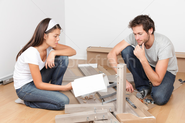 Couple moving in assembling bed furniture Stock photo © Maridav