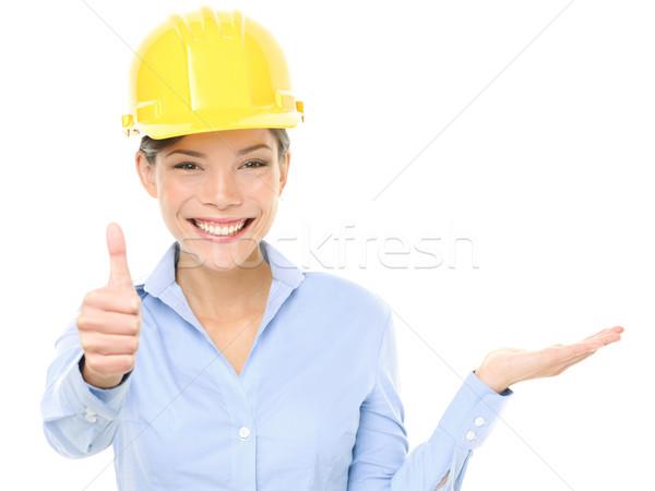 Engineer woman showing thumbs up and product Stock photo © Maridav