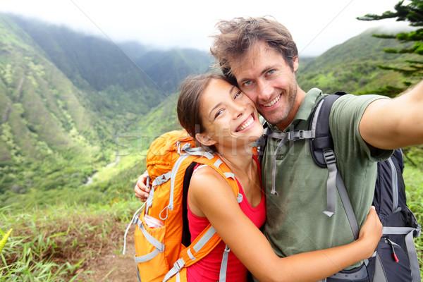 Hiking couple - young couple in love on Hawaii Stock photo © Maridav