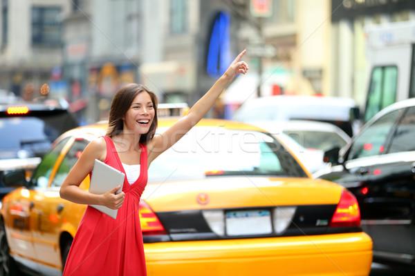 Girl calling taxi cab in New York City Stock photo © Maridav
