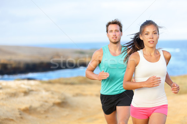 People jogging for fitness running outside Stock photo © Maridav