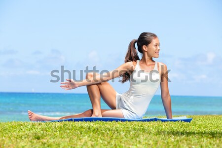 Woman stretching legs in yoga exercise fitness Stock photo © Maridav