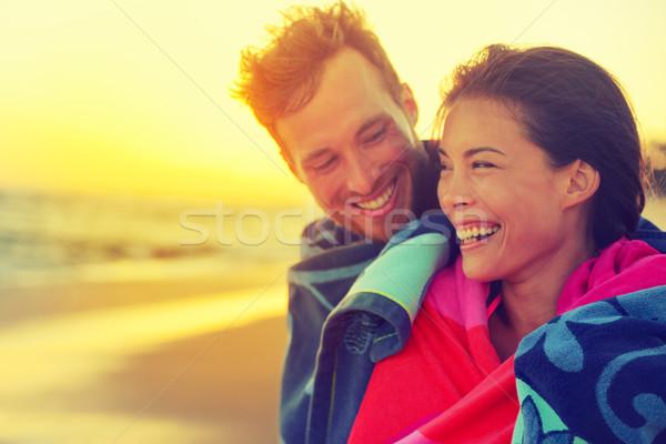 Bathing romantic couple with towel on beach sunset Stock photo © Maridav