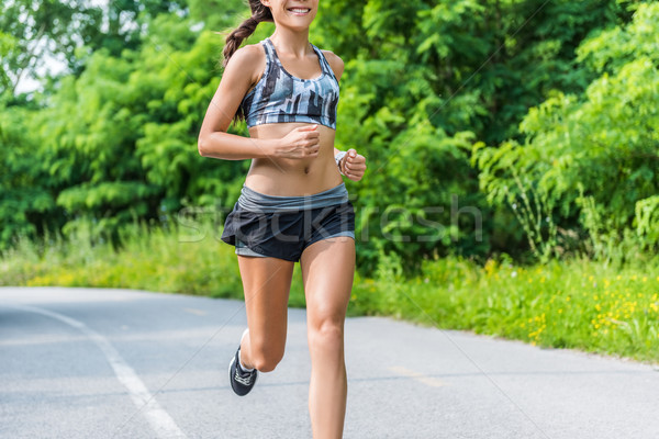 Stock photo: Fitness girl running in summer outdoor nature park