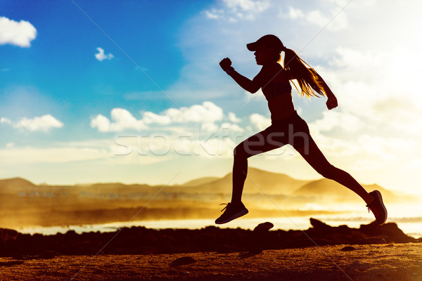 Silhouette athlete runner running in sunset Stock photo © Maridav