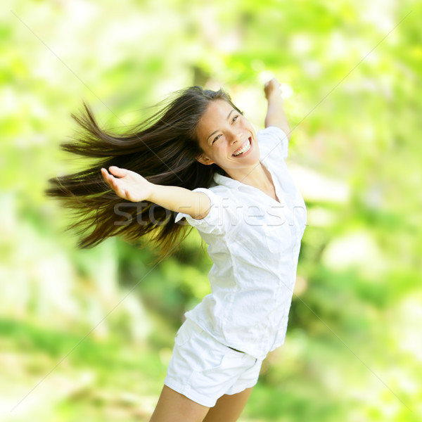 Rejoicing happy woman in flying motion Stock photo © Maridav