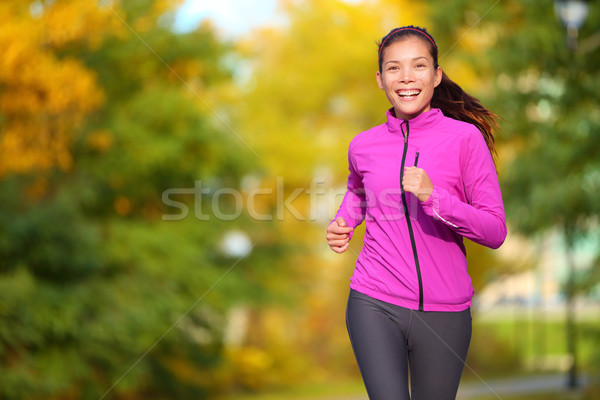 Female jogger - young woman jogging in the park Stock photo © Maridav