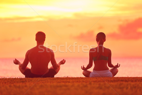 Meditation yoga couple meditating at beach sunset Stock photo © Maridav