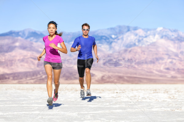 Runners trail running on dry desert landscape Stock photo © Maridav
