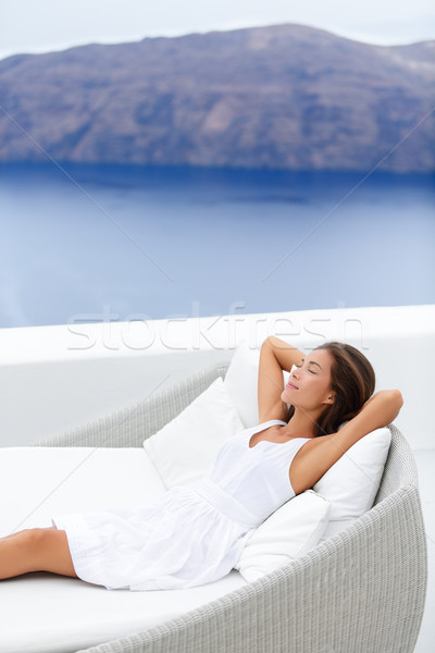 Woman Relaxing On Couch At Resort Terrace By Ocean Stock photo © Maridav