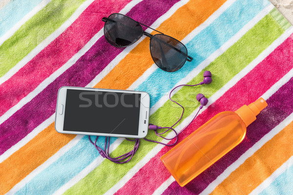 Summer vacation smartphone, sunglasses, sunscreen Stock photo © Maridav