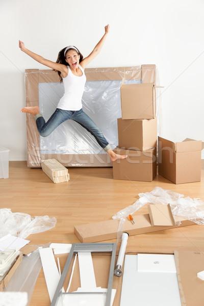 új otthon mozog nő izgatott boldog ugrik Stock fotó © Maridav