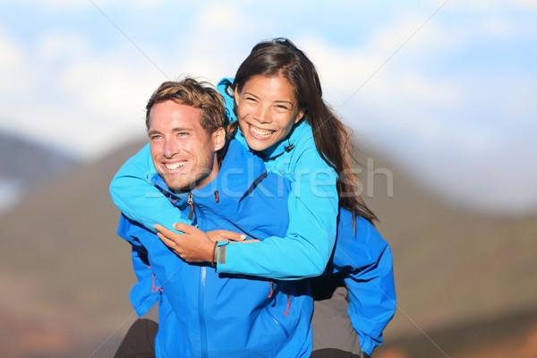 Happy hiking couple piggyback Stock photo © Maridav