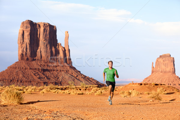 Runner - Running man sprinting in Monument Valley Stock photo © Maridav