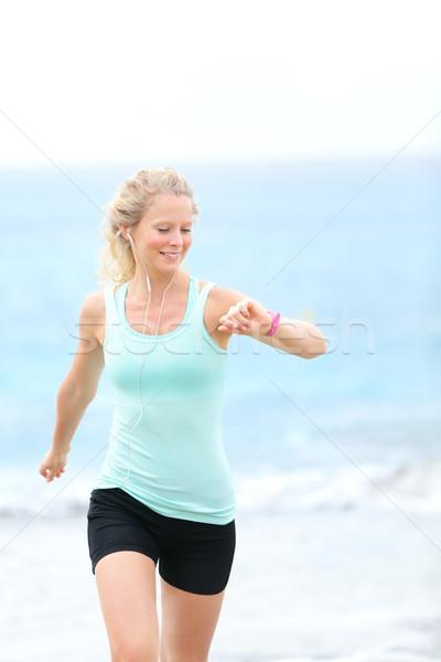 Running woman jogger with heart rate monitor watch Stock photo © Maridav