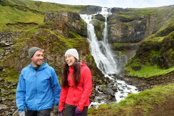 Hiking active couple fun by waterfall Iceland Stock photo © Maridav