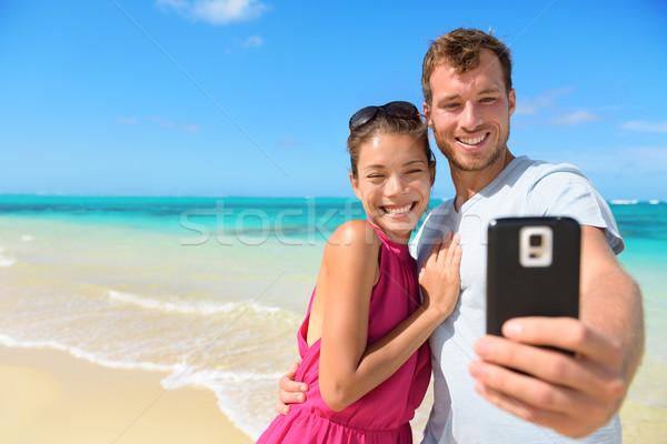 Stockfoto: Strand · vakantie · paar · smartphone · foto