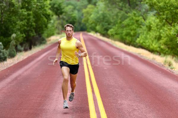 Running man runner sprinting for fitness health Stock photo © Maridav