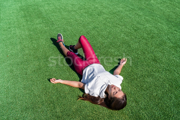 Tired athlete lying down after intense workout Stock photo © Maridav