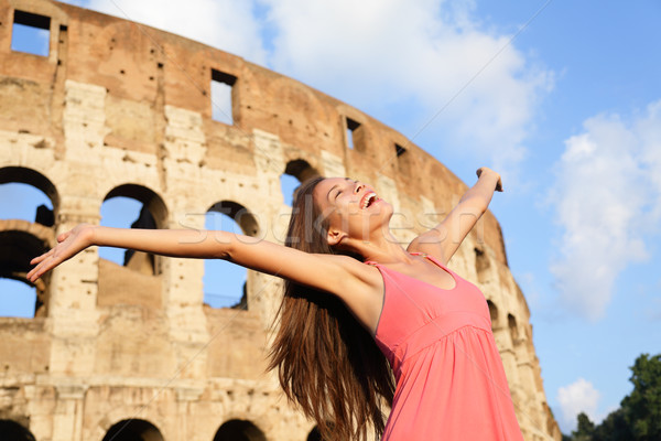 Happy carefree elated travel woman by Colosseum Stock photo © Maridav