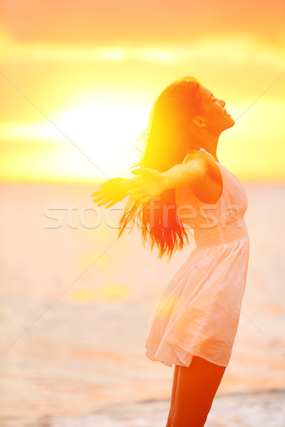 Freedom woman enjoying feeling happy free at beach Stock photo © Maridav