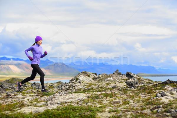 Trail running woman in cross country run Stock photo © Maridav