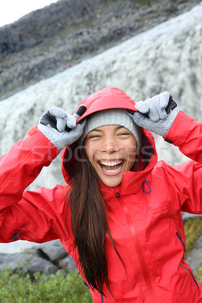 Woman laughing in raincoat by Dettifoss waterfall Stock photo © Maridav