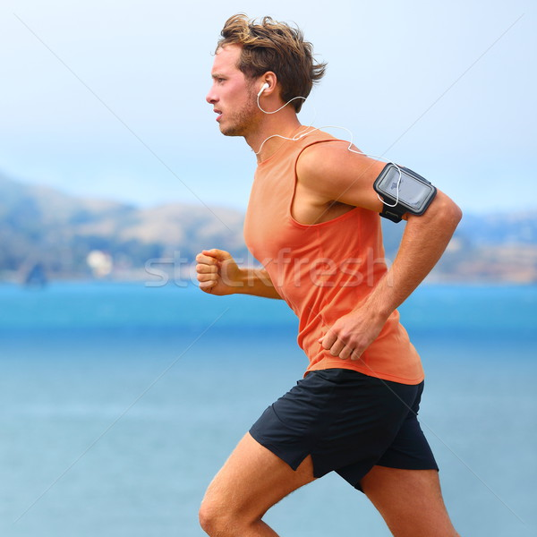 Running app on smartphone - male runner Stock photo © Maridav