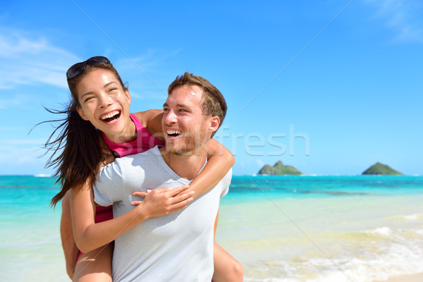 Plage couple rire Hawaii vacances Photo stock © Maridav