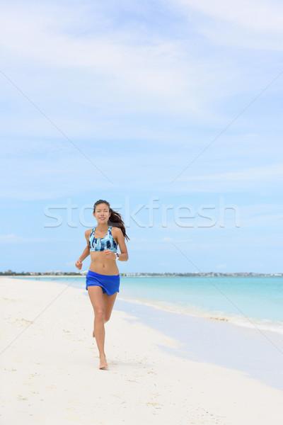 Praia corrida mulher manhã cardio exercício Foto stock © Maridav