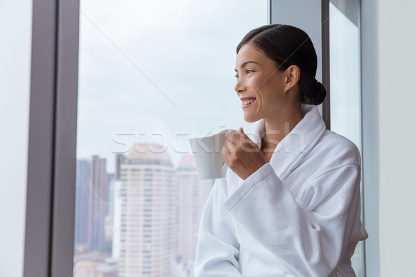 Stock photo: Hotel woman drinking morning coffee relaxing