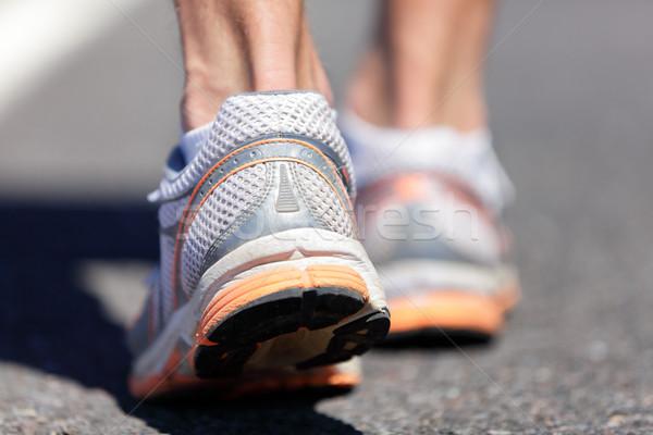 Running shoes feet closeup man jogging on road Stock photo © Maridav