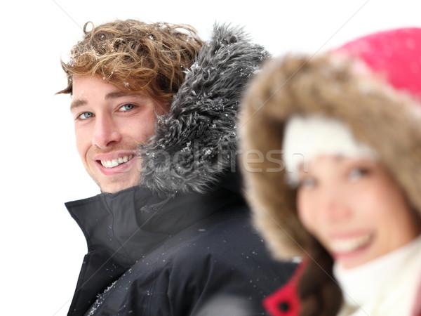 Outdoor couple smiling in winter snow Stock photo © Maridav