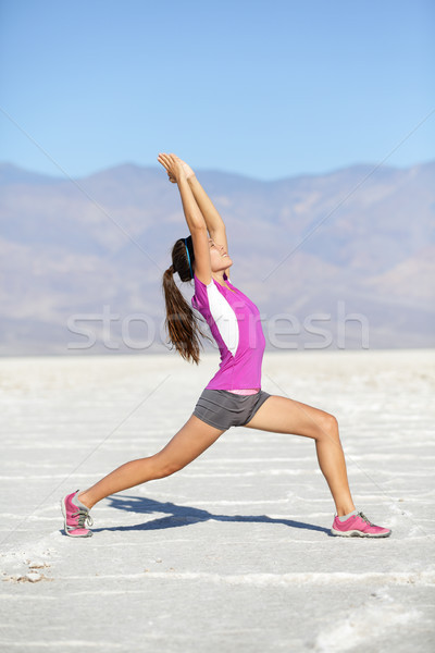 Fitness yoga woman stretching warrior one pose Stock photo © Maridav
