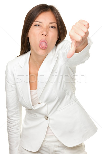 Businesswoman Teasing While Gesturing Thumbs Down Stock photo © Maridav