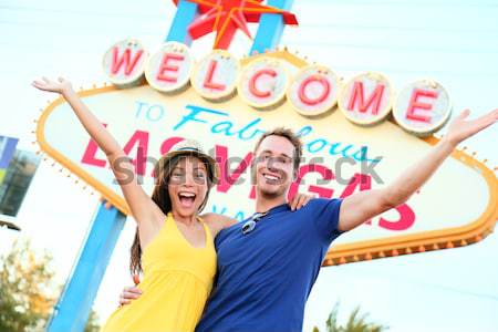 Tourist woman in Las Vegas sign posing happy Stock photo © Maridav