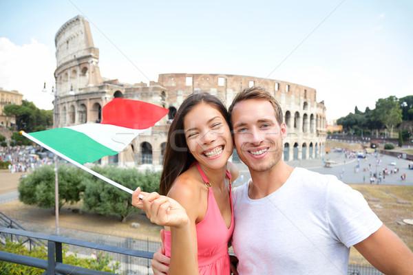 Italy travel couple with Italian flag by Colosseum Stock photo © Maridav